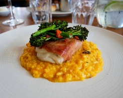 Roasted Hake wrapped in Serrano with a Saffron and Chorizo Risotto