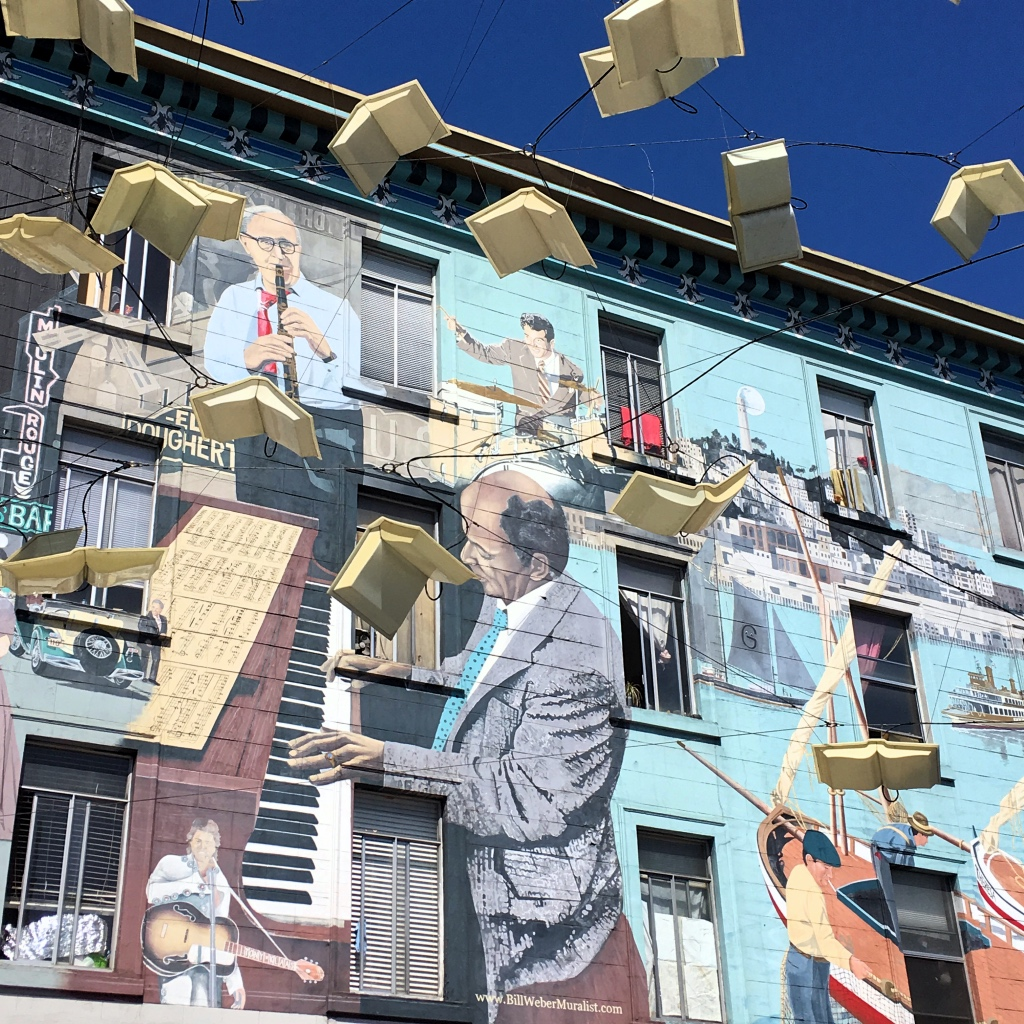 Wall mural with flying books in North Beach